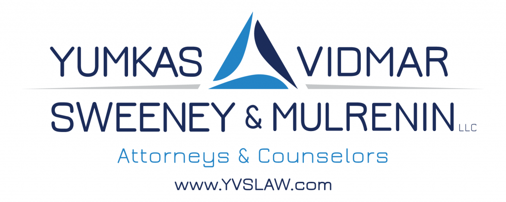 White logo with favicon for Yumkas, Vidmar, Sweeney & Mulrenin LLC, attorneys and counselors in Maryland.