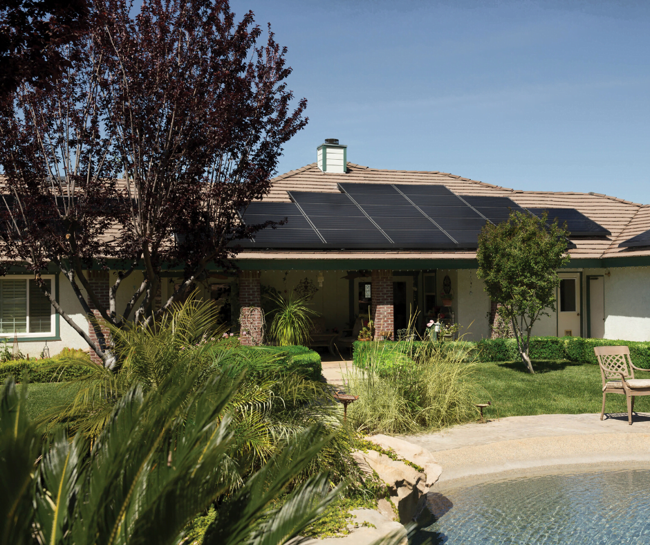 Single family home with a pool and plants in their backyard, and solar panels on their roof in relation to Maryland's solar roof panel architectural laws.